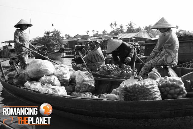 Woman selling fruits at the Cai Rang Floating Market