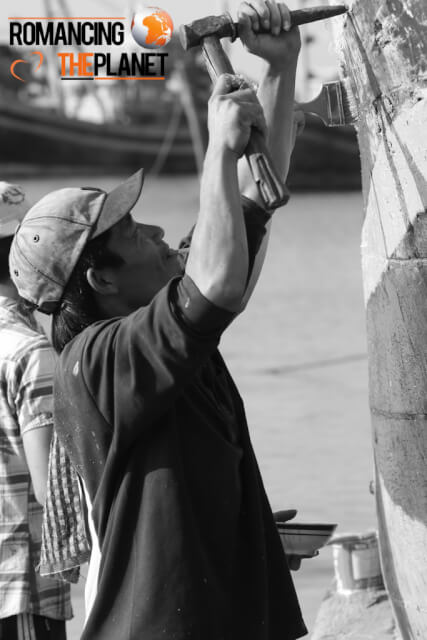 Carpenter doing the wook work on a shipping boat in Ninh Hoa, Vietnam