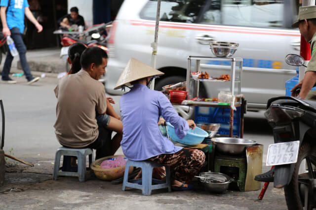 A women selling street food in Ho Chi Minh City
