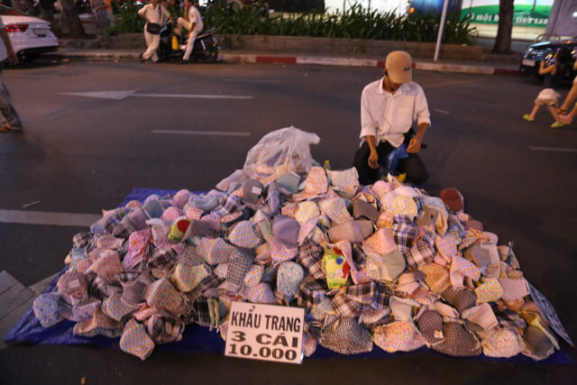 Buy a face mask when traveling in HCMC
