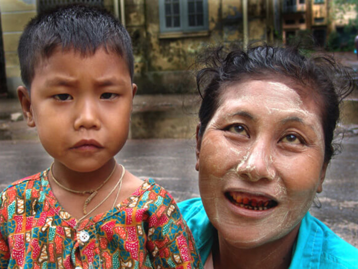 Burmese woman with teeth stained in red