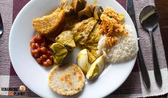 My breakfast at Jetwing Lagoon - Starting from boiled egg (left to right) Pol Roti, Bean Sauce, Hash Brown, Chicken Curry, Pol Sambol, String Hoppers & in between Fish Curry and Chinese Omelette.