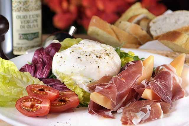 Burrata Pugliese which is a made from fresh Buratta Cheese, Mixed Salad, Parma Ham and Melon